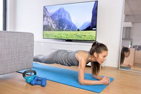 stock photo of in front  - Living room fitness workout  - JPG