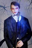 Постер, плакат: Портрет молодой красавец с вампира стиль макияжа Снят в студии
