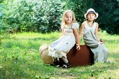 stock photo of little boy  - Two beautiful children walking together - JPG