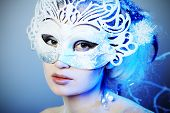 foto of masquerade mask  - Art portrait of a beautiful female model in a carnival mask - JPG