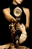stock photo of pendulum clock  - Sepia picture of a clock and beautiful young girl  - JPG