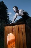 foto of werewolf hunter  - Scary man sitting on kennel and turning into werewolf - JPG