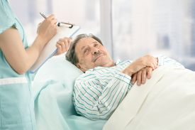 picture of hospital patient  - Nurse holding clipboard - JPG