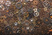 Layers of different cogwheels. Heavy machinery. Clockwork. poster