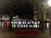 Motivational And Inspirational Quotes - Never Be Afraid To Stand Alone. With Blurred Vintage Styled  poster