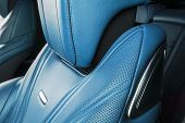 Modern Luxury Car Inside. Interior Of Prestige Modern Car. Comfortable Leather Red Seats. Blue Perfo poster