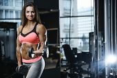 Strong Sexy Athletic Young Girl Working Out In Gym poster