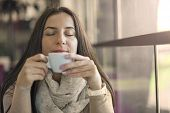 Portrait Of Young Gorgeous Female Drinking Cup Of Coffee And Enjoying Her Leisure Time. Business Wom poster