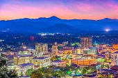 Asheville, North Carolina, USA skyline over downtown with the Blue Ridge Mountains. poster