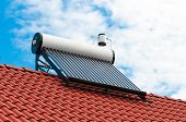 Solar Water Heater On Roof Top, Beautiful Blue Sky Background. poster