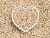 Quinoa In Heart-shaped Bowl On Quinoa Background. Gluten Free Ancient Grain For Healthy Diet. I Love poster