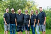 portrait of a senior couple with their five adult children. This large attractive family of adult ch poster