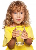 stock photo of drinking water  - Child with a glass of water isolated on white - JPG