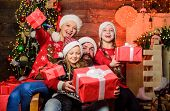 Christmas Joy. Happy Holidays. Parents And Children Opening Christmas Gifts. Father Santa Claus And  poster