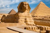 stock photo of the great pyramids  - A beautiful profile of the Great Sphinx including the pyramids of Menkaure and Khafre in the background in Giza Cairo Egypt - JPG
