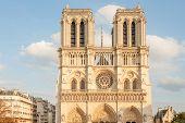 Sun Lit Undamaged Facade Of World Famous Notre Dame De Paris On Parvis Notre Dame (place Jean Paul I poster