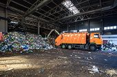Truck Throws Garbage At Sorting Modern Waste Recycling Processing Plant. Separate And Sorting Garbag poster