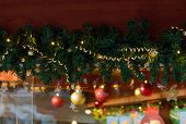 Green Fir Tree Garland From Branches With Golden Ribbons Red Balls Sparkling Lights As Christmas New poster