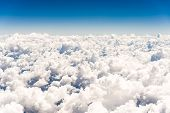 Abstract Skyscape Background With White Cumulus Clouds Against Blue Sky. poster