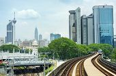 pic of klcc  - LRT train arrives at a train station in Kuala Lumpur - JPG