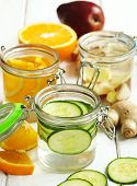 Healthy Spa Water With Fruit And Vegetable. Cucumber Spa Water, Pear And Ginger Spa Water And Orange poster