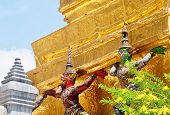 Demon Guardian Giant Statues Stand Around Pagoda And Liftting The Base Of The Golden Pagoda At Wat P poster