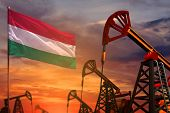 Hungary Oil Industry Concept, Industrial Illustration. Hungary Flag And Oil Wells And The Red And Bl poster