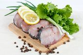 Fillet Of Fresh Raw Fish With Herbs, Lemon And Spicy Peppers poster