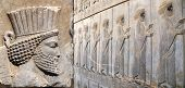 Horizontal banner with bas-relief with assyrian warriors with spears on ancient wall , Persepolis, I poster