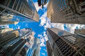 Uprisen Angle With Fisheye Scene Of Downtown Chicago Skyscraper With Reflection Of Clouds Among High poster