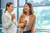Two Asian Businesswomen Talking During Coffee Break In Modern Office Or Coworking Space, Coffee Brea poster