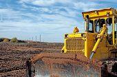 Large Construction Bulldozer At A Construction Site. Ground Planning At A Construction Site. Excavat poster