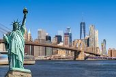 Statue of Liberty with background of Brooklyn bridge and Lower Manhattan skyscrapers bulding for New poster