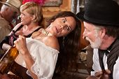 stock photo of gunfighter  - Pretty American Indian gunfighter talking with bartender - JPG