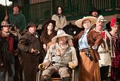 foto of antique wheelchair  - Wheelchair bound cowboy with wife and old west era gang - JPG