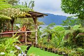 Family Travel Lifestyle. Happy Mother, Son Relax On Luxury Villa Veranda With Tropical Garden View.  poster