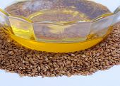 image of flaxseeds  - Flaxseed oil in bowl and whole flax seeds - JPG