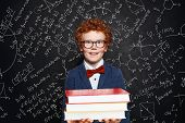 Clever Kid Boy In Glasses Holding Book, Portrait poster