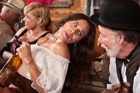 stock photo of gunfights  - Pretty American Indian gunfighter talking with bartender - JPG
