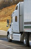 pic of 18 wheeler  - close up of a white tractor trailer semi truck - JPG