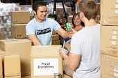 pic of tin man  - Volunteers Collecting Food Donations In Warehouse - JPG