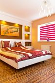 picture of master bedroom  - Master bedroom interior with picture of shipwreck on the wall - JPG