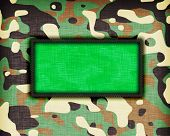 stock photo of ami  - Amy camouflage uniform with flag on it Libya - JPG
