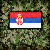 stock photo of ami  - Amy camouflage uniform with flag on it Serbia - JPG