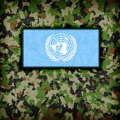 stock photo of ami  - Amy camouflage uniform with flag on it UN - JPG