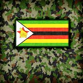 stock photo of ami  - Amy camouflage uniform with flag on it Zimbabwe - JPG