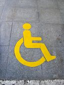 stock photo of physically handicapped  - Yellow handicapped sign of floor tile as background