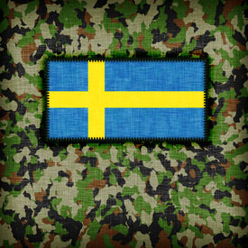 stock photo of ami  - Amy camouflage uniform with flag on it Sweden - JPG