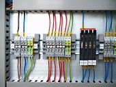 stock photo of contactor  - A part of cubicle with Distribution Rail terminal and relays - JPG