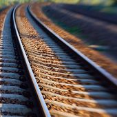 picture of track field  - Blur  of iron line of railway  track
